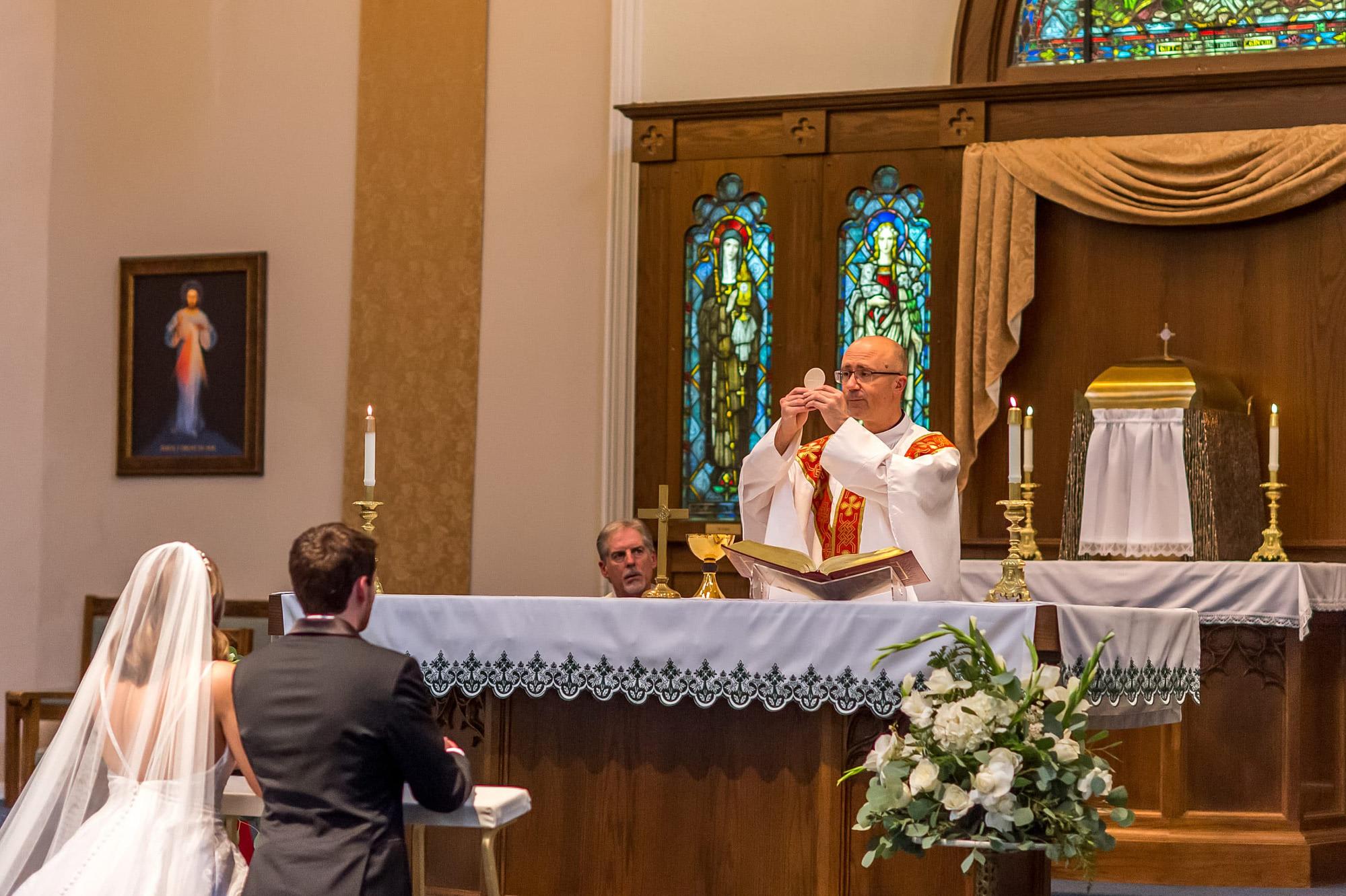 Nuptial wedding Mass during Blessed Sacrament Denver wedding ceremony.