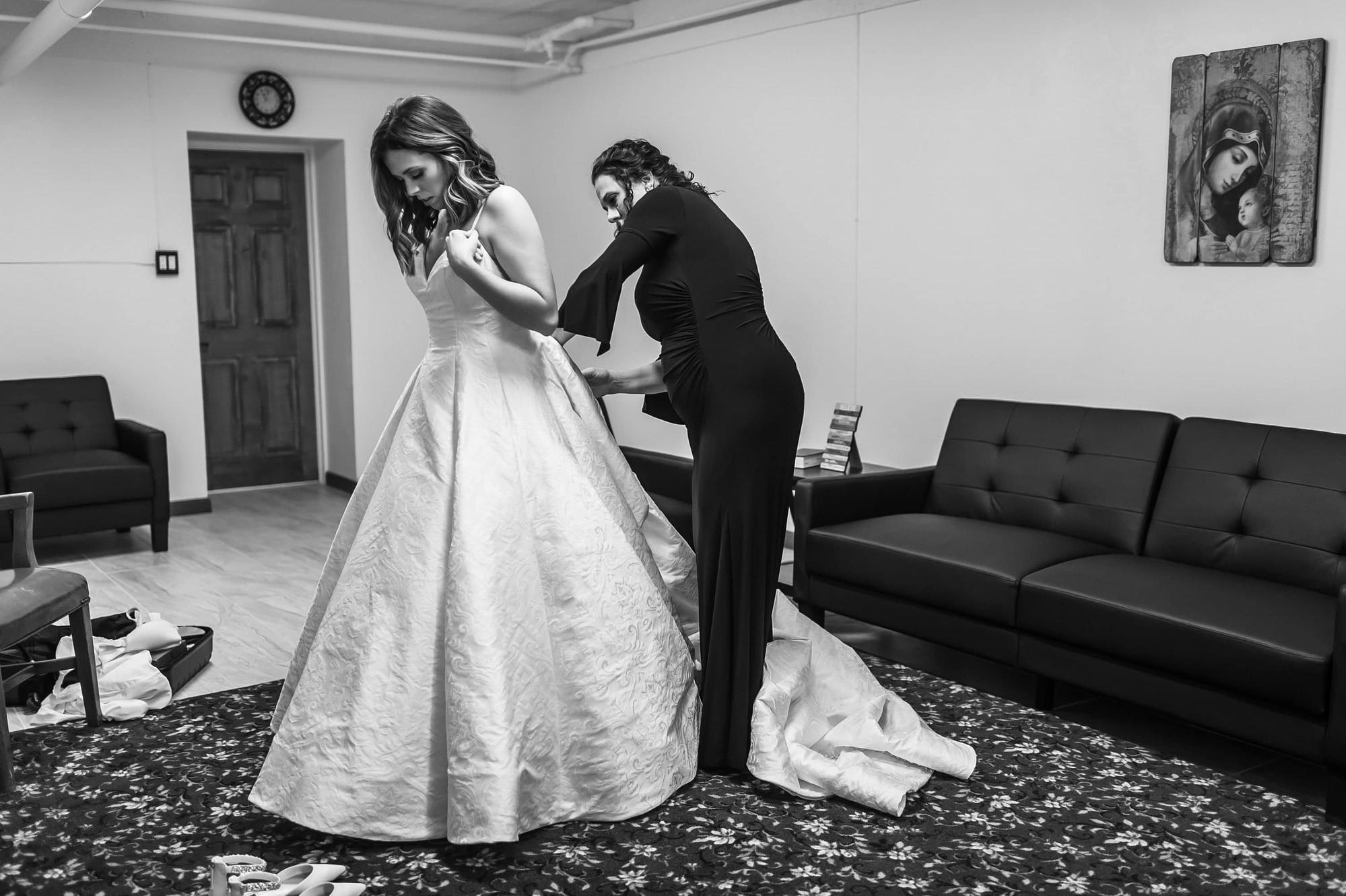 Bride gets ready during a Blessed Sacrament Denver wedding.