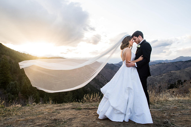 Bride and groom pose for Lookout Mountain Colorado wedding photos.
