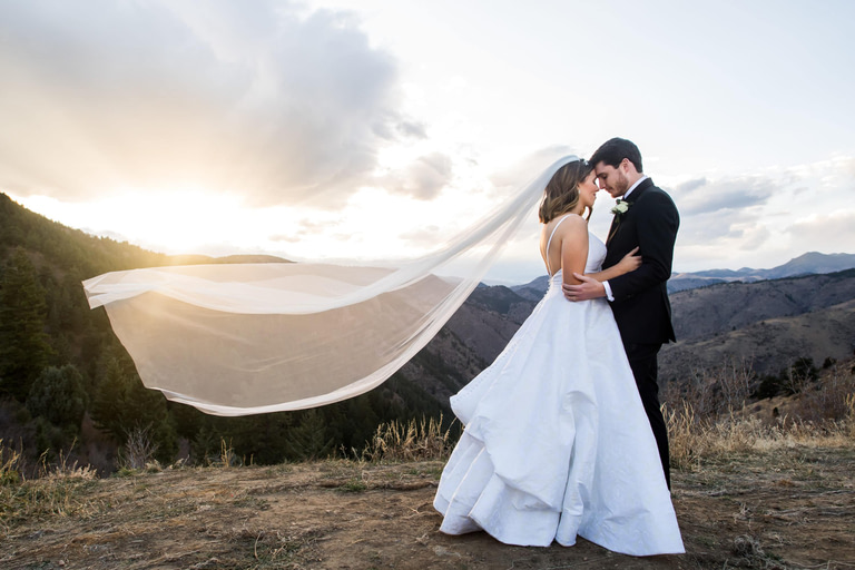 Bride and groom pose for Lookout Mountain Colorado wedding photos.