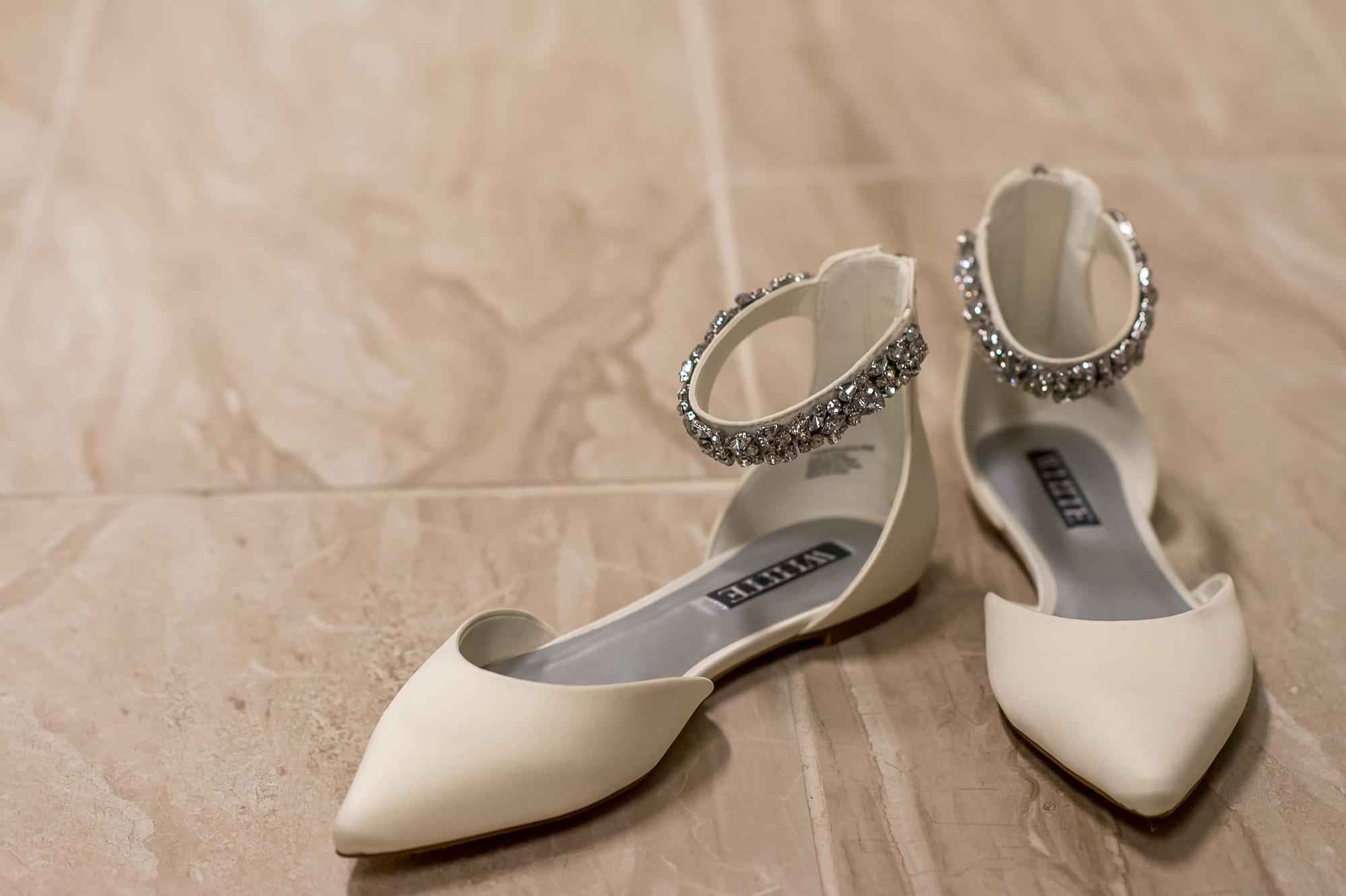 Shoes during a Blessed Sacrament Denver wedding.